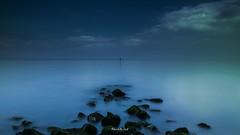 Old Colwyn waterfront (Mark Palombella Hart) Tags: cymru landscape sea sky clouds rocks tourism