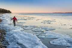 Solitary man walks along icy shoreline of Ontario lake (blurMEDIA Stock) Tags: canada canadianshield earth georgianbay ontario ancient blue chemistry clean climate climatechange cold colortemperature cool crystal environment environmental explore fragile fragility freezing frigid frozen globalwarming ice icecube icicle icy journey kelvin lake lakeice landscape lifestyle light man melt mood nature north northern outdoor phasechange planet pure purity refreshing shoreline solitary solitude stewardship sunset thaw warm warming water whitebalance wilderness winter