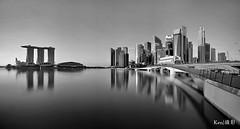 Panoramic View of Jubilee Bridge (B&W) (Ken Goh thanks for 2 Million views) Tags: singapore skyline sunrise morning sun blue sky reflection water smooth longexposure ndfilter marina bay sand cbd centralbusinessdistrict mbs cloud nopeople bw monchrome pentax k5iis sigma 1020