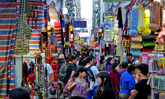 Hong Kong street market. (Bernard Spragg) Tags: market asia people crowds lumix hongkong mongkok street urban shopping traders colours