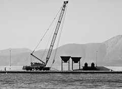 Works in progress (jimiliop) Tags: port works towtruck construction sea blackwhite monochrome workers mountains high working geometry