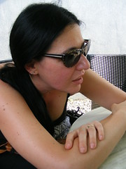 The joys of Summer in the Balkans - June 2017 (sean and nina) Tags: nina sean couple married man woman male female happy smile smiling ice cream juice coke treat cafe bar outdoor table food drink summer june 2017 croatia croatian serb irish hrvatska people persons balkan balkans eu europe european sunglasses beauty beautiful gorgeous stunning charm charming wife husband fiancee fiance brunette neck throat skin tan tanned pink lips face shoulders spaghetti strap black top shirt arms bare long short hair candid fun