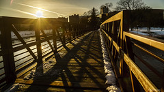 We'll Cross the Bridge when we come to it (Neha & Chittaranjan Desai) Tags: bridge wooden plank rochester minnesota usa travel golden hour city cityscape sunset dusk snow winter