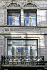 12 (roberke) Tags: ramen vensters windows reflections reflecties reflectie balkon smeedwerk outdoor sunlight sunbeams zonlicht zonnestralen architecture architectuur gebouw house huis