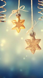 Christmas golden star ornaments at night