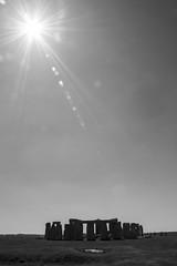 Under the sun (stopdead2012) Tags: wiltshire stonehenge sky sun monochrome landscape stones rocks