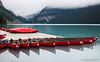 Canoes and Cloud at Lake Louise (Peter Starling) Tags: canada peterstarling canadian canoe morning water rocky rockies mountain mountains mist fog blue red banff national park glacier victoria glacial pontoon canoes canon 50d quiet alberta