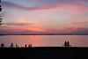 Sunset in James Madison Park (danielhast) Tags: madison wisconsin lakemendota park people silhouette sunset sky water lake mendota boat bicycle jamesmadisonpark