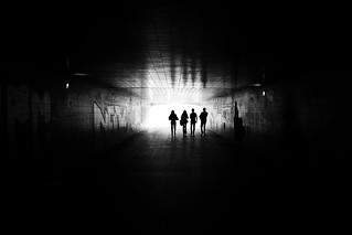 Bystanders approaching the light