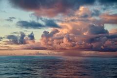 Sunset off the Cook Islands (adamsgc1) Tags: sunset cookislands clouds rain raincloud cunardline queenelizabeth ocean