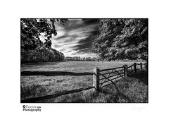 Field and Fence (<Derek>) Tags: field fence monochrome mono bw blackandwhite gate sky clouds