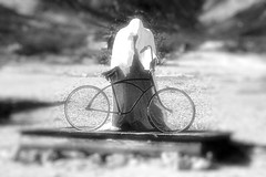 Ghost Rider (Faux Infrared) (EmperorNorton47) Tags: rhyolite nevada photo digital spring blackandwhite monochrome fauxinfrared statues charlesalbertszukalski statue sculpture goldwellopenairartmuseum goldwellopenairmuseum ghostrider bicycle ghost depthoffield blurred desert