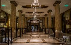 2018 - Romania - Bucharest - Athenée Palace Hilton - 2 of 2 (Ted's photos - Returns Late November) Tags: 2018 bucharest cropped nikon nikond750 nikonfx romania tedmcgrath tedsphotos vignetting athenéepalacehilton lobby columns tile marble hotel hotellobby hall hallway