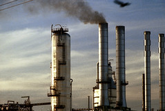 1a-487 (ndpa / s. lundeen, archivist) Tags: nick dewolf nickdewolf photographbynickdewolf 1978 1970s color 35mm film 1a reel1a louisiana southernlouisiana neworleans industry oilrefinery oilrefineries smokestack smokestacks smoke bird sky clouds refinery