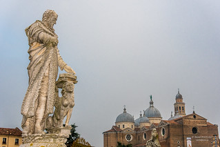 Statue at Prato della Valle with a view of theBasilica of St. Justina of Padua, Italy
