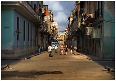 street lives (kurtwolf303) Tags: 2015 cuba lahabana sky street strase havanna kuba karibik caribbean persons streetphotography architecture buildings clouds gehsteig olympusem5 omd systemcamera mft kurtwolf303 mirrorlesscamera micro43 urbanscenery urban microfourthirds urbanlifeinmetropolis
