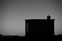 Horizon from houses (Adabo!) Tags: black white bw horizon house outdoor window chimney dark pentax