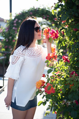 DSC_6046 (Diego California) Tags: glasses fashion white bag smelling roses jeans flowers