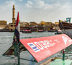 Abra (Aleem Yousaf) Tags: downtown colorful dof flag boats ship docks afternoon asia middle east town bur dubai water taxi outside shallow bright flickr pretty rta transportation authority mosque minaret united arab emirates travel tourist camera nikon 2470mm nikkor abra 72 creek sign building boat