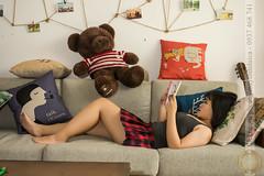 Lying and reading book on sofa (Hosting and Web Development) Tags: lie hand arm body sofa leg hair enjoy morning reading one young girl pillow nikon teddy d7100 bear