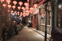 Beijing Street Scene (iammattdoran) Tags: beijing china street scene streetscape backstreet sidestreet lanterns colour sony a6000 travel life living eating trike tricycle rickshaw restaurant urban night nocturnal qianmen dark world photography