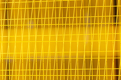 Calgary Construction Fence (josullivan.59) Tags: alberta calgary canada canon6d dof tamron abstract blur fence metal telephoto yellow wallpaper 3exp evening texture tamron150600 urban outside pattern artistic detail day downtown geometric clear minimalism