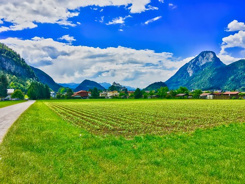 Field outside Kufstein with fortress and Pendling mountain in the river Inn valley, Tyrol, Austria