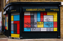 Isambard's Cycles (Steve Taylor (Photography)) Tags: isambardscycles 240bricklane shop alarm graffiti mural streetart black brown red white yellow grey blue tag contrast uk gb england greatbritain unitedkingdom london shape oblong shutter