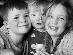 Family is all (livsillusjoner) Tags: monochrome bw blackwhite blackandwhite black grey white portrait people faces kid kids young child children smile smiling family brother sister toddler boy boys girl