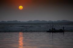 "A Boat & The Rising Sun On A Cloudy Morning On The Ganges, Varanasi (El-Branden Brazil) Tags: varanasi india indian ganges ganga ceremony hindu hinduism asian asia sacred holy mystical ""south asia"" sadhu"