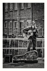 Week 23/52 - Technical f/8 Portrait (Mark Curnow Photography) Tags: falmouth princeofwalespier busker f8 portrait outdoor music guitar man people blackwhite monocrome snapseed vignette blur greyscale