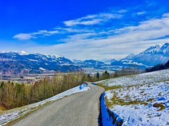 Winter landscape with the Alps near Oberaudorf, Bavaria, Germany (UweBKK (α 77 on )) Tags: winter landscape scenery panorama alps mountains fields road street sky clouds blue white view bavaria bayern germany deutschland europe europa iphone