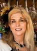 Beautiful Smile (wyojones) Tags: texasrenaissancefestival texas trf renaissance renfest faire festival blonde beauty beautiful smile woman blueeyes pretty necklace feather facepaint freckles toddmission