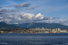 North Vancouver & North Shore Mountains (SonjaPetersonPh♡tography) Tags: vancouver bc canada waterfront skyline landscape waterscape britishcolumbia nikond5300 nikon scenery scenic viewpoint stanleypark stanleyparkseawall city cityscape northvancouver northshore northshoremountains mountains coastalmountains mountainlandscape clouds sky bluesky