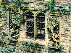 The Lion and the Unicorn (Steve Taylor (Photography)) Tags: lion unicorn leadedights crown art architecture digital building window black green brown stone glass uk gb england greatbritain unitedkingdom london weeds plant texture elthampalace stonework