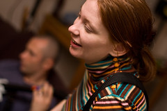Laughing (Jeremy Caney) Tags: birthdayparties blue brown colorful friends hearts houseparties housewarmingparties johns30thbirthday johnshouseparty laughing lippiercing longhair orange parties piercing redhair smiling straighthair stripes turtleneck woman women