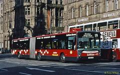 FJ53 LZX on hire to Lothian Buses Volvo B7LA with Hispano body in Princes Street Edinburgh Oct05 (Copy) (focus- transport) Tags: articulated bendibuses artics bendis first york manchester arriva london national express west midlands mainline south yorkshire transport pte nottingham city stagecoach emms hampshire lothian buses mercedesbenz 0530g citaro scania n94ua cn94ua omnicity man sgr192r goppell wright solar fusion eclipse streetcar leyland dab hispano jonckheere modulo volvo b7la b10ma b10la