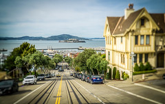 Alcatraz from Powell St. Streetcar (SPP - Photography) Tags: alcatrazisland costal pacificocean city cityscape boats costline california alcatraz fishermanswharf ocean sanfrancisco marina hills cars island streetcar boat coastline coast docks pacificcoast