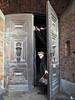 Krakow -  -3240247 (Neil.Simmons) Tags: poland krakow streetphotography church door open lady woman glance