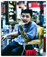 Naked Barber Shop (paulh192) Tags: nakedbarbershop bangkok thailand runway3119 people candid tattoo art bokeh leicasl