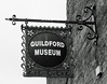 Guildford Museum Sign (Song-to-the-Siren) Tags: blackandwhite olympus35sp tmax100 bw classiccamera filmcamera film analogue guildford towncentre