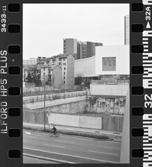 NCP_002 (nocrop.project) Tags: ncp nocropproject filmphotography filmisnotdead grainisgood istillshootfilm monochrome blackandwhite 35mmfilm analogue photography darkroom neorealism streetphotography ordinarylife canon ae1 fomapan 400 self developed milan italy man bycicle cityscape