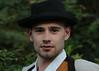 Smile (Dragan*) Tags: boy guy man portrait face eyes costume outdoor jovan hat