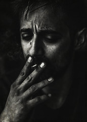 Giorgos (Johnidis) Tags: portrait male man smoking smoke cigar cigarette monochrome bw blackandwhite black expression hand low key contrast dark