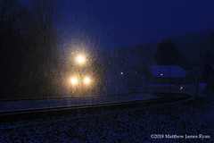 Silence Illuminated (Wanderer Photography) Tags: ns norfolk southern ge general electric emd train engine locomotive pennsylvania lilly west slope pittsburgh line snow blizzard winter cold dusk headlight railroad railway rail intermodal