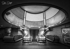 Southwark. (Sue Sayer) Tags: tube station underground london southwark mono bw escalator concourse