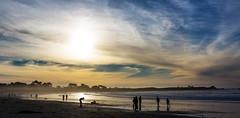 6644a  Shootin' the Dog (foxxyg2) Tags: sun sunset dusk sky clouds sand gold blue people silhouettes asilomar asilomarbeach pacificgrove pacificocean california