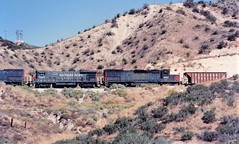 Southern Pacific B36-7 and SD40T-2 locomotives at Cajon Summit in 1992 (Tangled Bank) Tags: train trains railway railways railroad railroads 1990s 90s fallen flags old classic heritage vintage north american southern pacific sp cajon summit pass california espee locomotive engine diesel