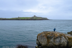 Island view - DSC_0354 (John Hickey - fotosbyjohnh) Tags: 2018 june2018 sorrento dalkey dublin ireland fisherman island tower rocks sea water coast coastline irishsea mist seaview person