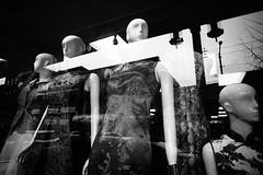 Chinatown reflections (Eric Flexyourhead) Tags: vancouver canada britishcolumbia bc chinatown eastpender penderstreet city urban detail fragment shop store window reflection chinese dress mannequin monochrome blackwhite bw sonyalphaa7 voigtlandercolorskopar21mmf4 voigtlander 21mmf4